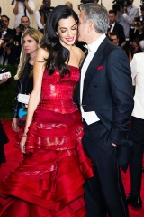 """George Clooney and Amal Clooney arrive at The Metropolitan Museum of Art's Costume Institute benefit gala celebrating """"China: Through the Looking Glass"""" on Monday, May 4, 2015, in New York. (Photo by Charles Sykes/Invision/AP)"""