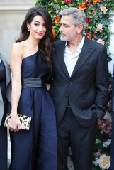 People's Postcode Lottery Gala. George and Amal Clooney, representing the Clooney Foundation for Justice, arrive at the People's Postcode Lottery charity gala at the McEwan Hall in Edinburgh. Picture date: Thursday March 14, 2019. Photo credit should read: Andrew Milligan/PA Wire URN:41764063 (Press Association via AP Images)