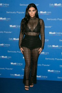 kim-kardashian-pregnancy-cleavage-bump-in-sheer-crochet-dress-gty-ftr1