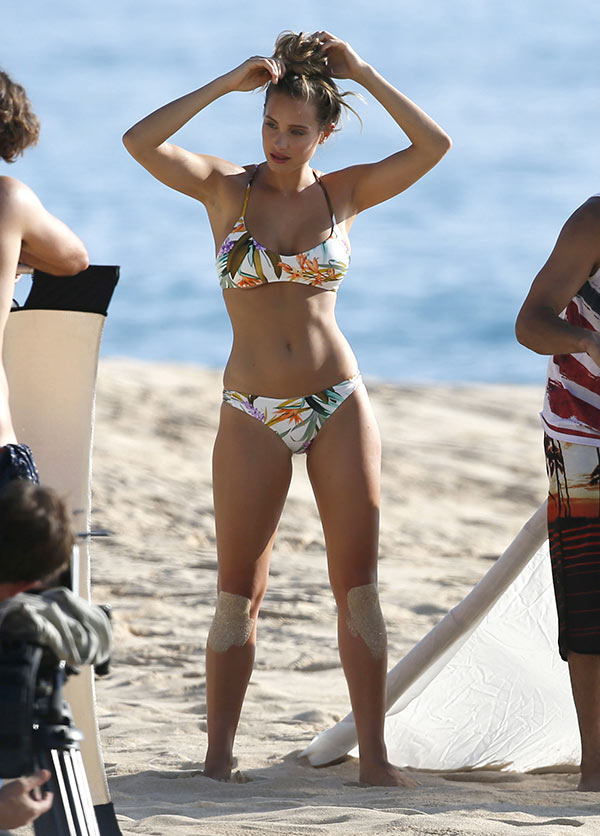 With her slim body and Light brown hairtype without bra (cup size 34A) on the beach in bikini