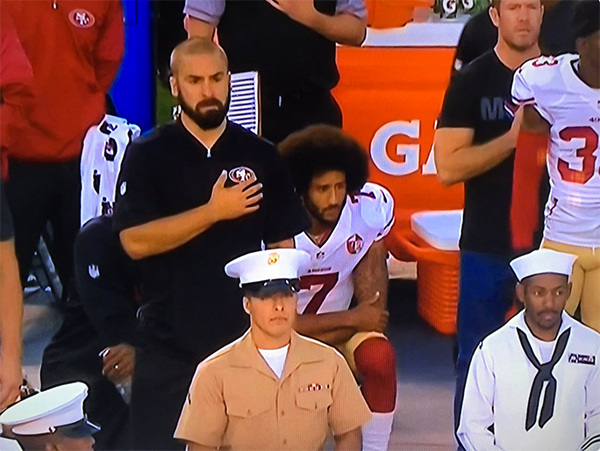 Colin Kaepernick Refuses To Stand