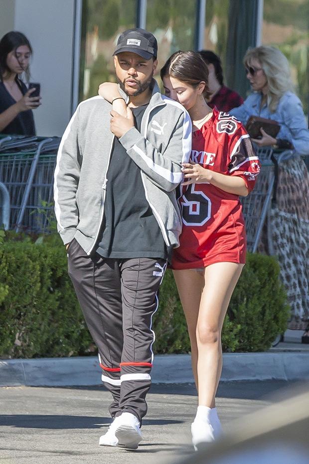 Selena Gomez Kissing The Weeknd's Shoulder