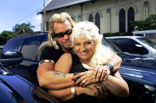 Editorial use only Mandatory Credit: Photo by David Howells/Shutterstock (602297b) Duane 'Dog' Chapman, AKA Dog the Bounty Hunter with his wife Beth. Duane 'Dog' Chapman in his office in Honolulu, Hawaii, America - 10 Jul 2006