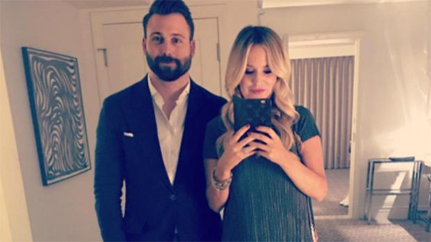 Pregnant Emily Maynard with her husband Tyler Johnson
