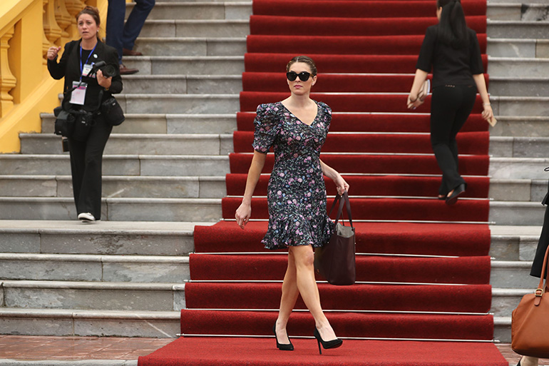 President Donald Trump's White House Communications Director Hope Hicks walks outside ahead of a news conference by President Donald Trump and Vietnamese President Tran Dai Quang at the Presidential Palace, in Hanoi, Vietnam. Trump is on a five country trip through Asia traveling to Japan, South Korea, China, Vietnam and the Philippines Trump , Hanoi, Vietnam - 12 Nov 2017
