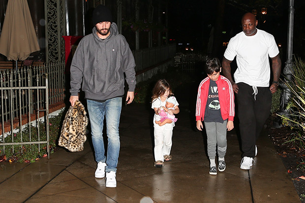 Penelope Disick clutches her doll while out with dad Scott and brother Mason