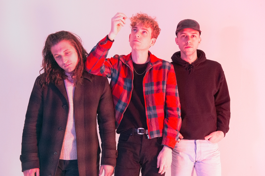"""COIN stops by HollywoodLife.com to talk about their new single """"Growing Pains"""" and 2018 tour."""