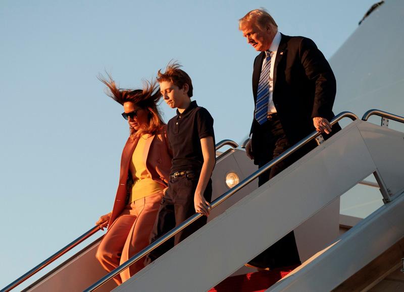 Donald Trump, Melania Trump, Barron Trump. President Donald Trump, first lady Melania Trump and their son Barron Trump, arrive on Air Force One at Palm Beach International Airport, in West Palm Beach, FlaTrump, West Palm Beach, USA - 23 Mar 2018