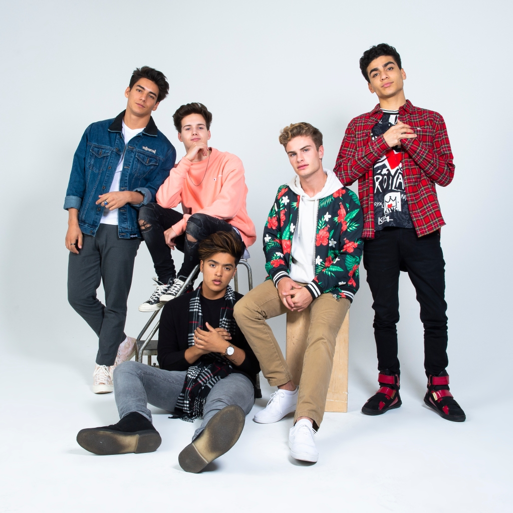 """In Real Life stops by HollywoodLife.com to talk about their new single """"Tattoo (How 'Bout You)."""""""