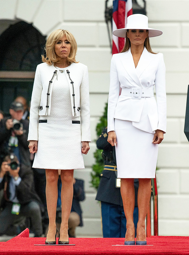 Brigitte Trogneux and Melania Trump on the South Lawn of the White House in Washington DC. French President Emmanuel Macron visit to USA - 24 Apr 2018 United States President Donald J. Trump and first lady Melania Trump host an arrival ceremony for President Emmanuel Macron of France and his wife, Brigitte Macron, on the South Lawn of the White House in Washington, DC.