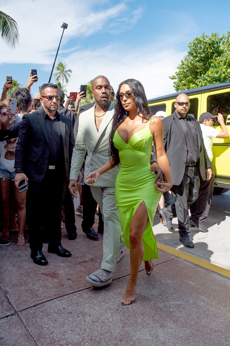 Kim Kardashian shined extra bright in neon and she and Kanye West arrive at Miami's Versace Mansion for rapper 2Chainz Wedding on Saturday (aug 18). The fashion diva wore a fluorescent yellow gown for the extravagant ceremony, while her hubby bared his chest in a light colored suit. Rapper 2 Chainz was tying the knot with fiancee Kesha Ward at Gianni Versace's famed Casa Casuarina on Ocean Drive. The celebrity arrivals caused a major buzz for tourists who stopped to snap photos.Pictured: Ref: SPL5016962 180818 NON-EXCLUSIVE Picture by: Garguibo / SplashNews.com Splash News and Pictures Los Angeles: 310-821-2666 New York: 212-619-2666 London: 0207 644 7656 Milan: +39 02 4399 8577 Sydney: +61 02 9240 7700 photodesk@splashnews.com World Rights
