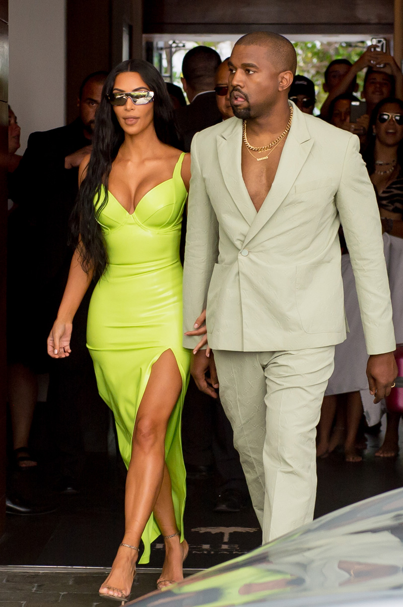 Kim Kardashian shined extra bright in neon and she and Kanye West arrive at Miami's Versace Mansion for rapper 2 Chainz's wedding on Saturday, Aug. 18. The fashion diva wore a fluorescent yellow gown for the extravagant ceremony, while her hubby bared his chest in a light colored suit. Rapper 2 Chainz was tying the knot with fiancee Kesha Ward at Gianni Versace's famed Casa Casuarina on Ocean Drive. The celebrity arrivals caused a major buzz for tourists who stopped to snap photos. sPictured: Kim Kardashian,Kanye WestRef: SPL5016965 180818 NON-EXCLUSIVEPicture by: AM/Brian Prahl/Splash News / SplashNews.comSplash News and PicturesLos Angeles: 310-821-2666New York: 212-619-2666London: 0207 644 7656Milan: +39 02 4399 8577Sydney: +61 02 9240 7700photodesk@splashnews.comWorld Rights
