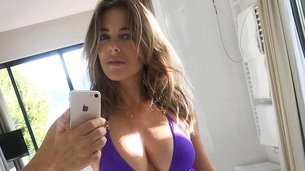 elizabeth hurley purple one piece bathing suit