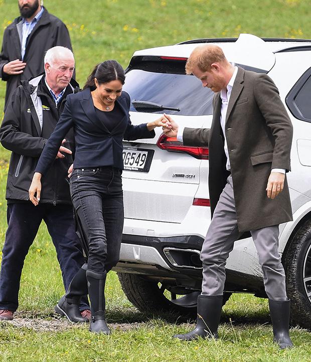 Meghan Markle Prince Harry hug hold hands