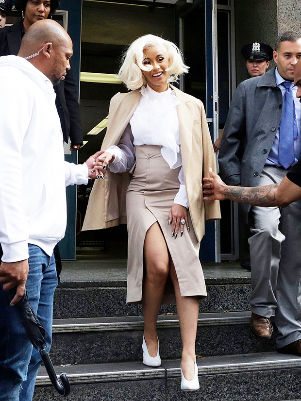 Rapper Cardi B is assisted by security guards as she leaves a police precinct, in the Queens borough of New York. The rapper met with police as part of an investigation of her possible involvement in a fight at a strip club Cardi B Strip Club Fracas, New York, USA - 01 Oct 2018