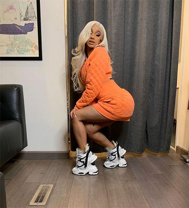 Cardi B In An Orange Mini Skirt