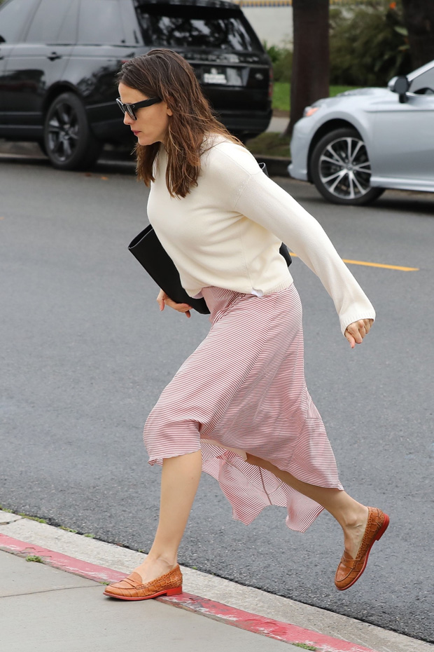 Pacific Palisades, CA - Jennifer Garner and Ben Affleck don't let the rain stop them as they arrive for Sunday church services. The pair, who are committed to coparenting their kids, arrived in separate cars, with the kids riding with Ben in the Range Rover, and Jen arriving with wet hair in the Lexus sedan. Ben looks like he's stepping up and taking parenting duties seriously, as he and eldest daughter Violet shared a sweet bonding moment as they entered the church together.Pictured: Jennifer Garner BACKGRID USA 3 FEBRUARY 2019 BYLINE MUST READ: Lastarpix / BACKGRID USA: +1 310 798 9111 / usasales@backgrid.com UK: +44 208 344 2007 / uksales@backgrid.com *UK Clients - Pictures Containing Children Please Pixelate Face Prior To Publication*