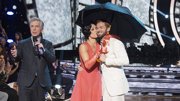 """DANCING WITH THE STARS - """"Episode 2506"""" - The nine remaining couples set their sights on the glitz and glamor of Tinseltown as they dance to celebrate """"A Night at the Movies,"""" on """"Dancing with the Stars,"""" live, MONDAY, OCTOBER 23 (8:00-10:01 p.m. EDT), on The ABC Television Network. (ABC/Eric McCandless)TOM BERGERON, NIKKI BELLA, ARTEM CHIGVINTSEV"""