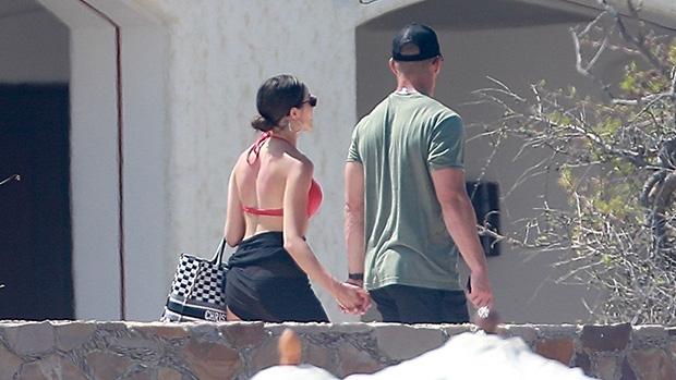 Olivia Culpo & Christian McCaffrey holding hands