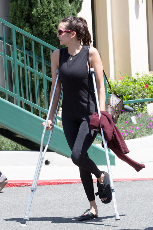 Nina Dobrev on crutches