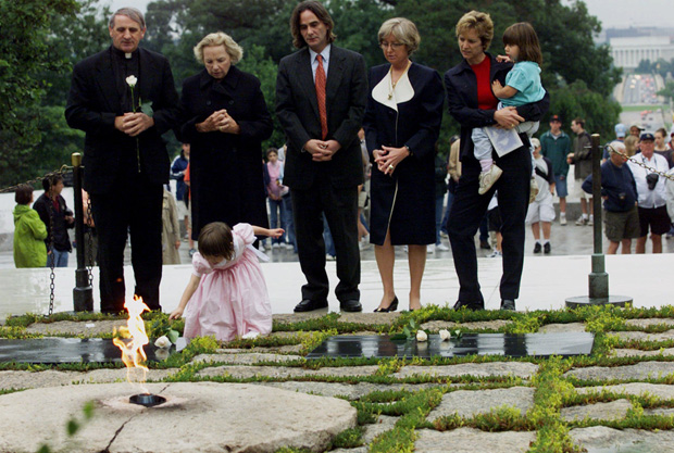 CAPTION CORRECTION Robert F. Kennedy's granddaughter Saoirse Kennedy Hill places a white rose at the Eternal Flame, President John F. Kennedy's gravesite, at Arlington National Cemetery in Arlington, Va., . Earlier the group took part in a ceremony honoring the 38th anniversary of Robert F. Kennedy's death. Kennedy was shot in Los Angeles on June 5, 1968. From left are, Father Gerry Creedon; Ethel Kennedy, RFK's widow; Paul Hill; Courtney Kennedy Hill; and Kerry Kennedy Cuomo, holding daughter MichaelaRFK, WASHINGTON, USA