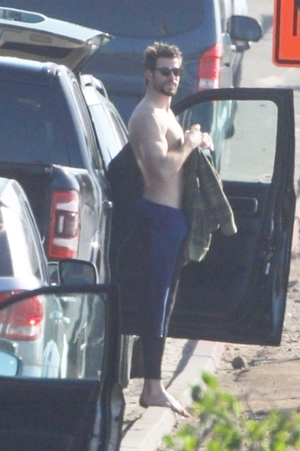 Liam Hemsworth surfing
