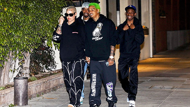 Amber Rose & A.E. holding hands while out to dinner
