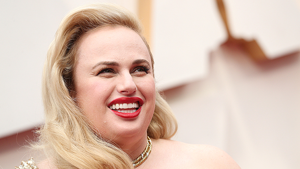 Rebel Wilson Stuns The Oscars Red Carpet In Glamorous Gold Gown