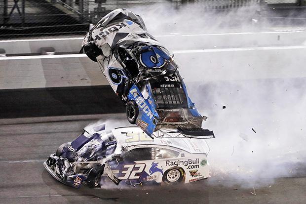 Ryan Newman (6) goes airborne after crashing with Corey LaJoie (32) during the NASCAR Daytona 500 auto race Monday, Feb. 17, 2020, at Daytona International Speedway in Daytona Beach, Fla. (AP Photo/Chris O'Meara)