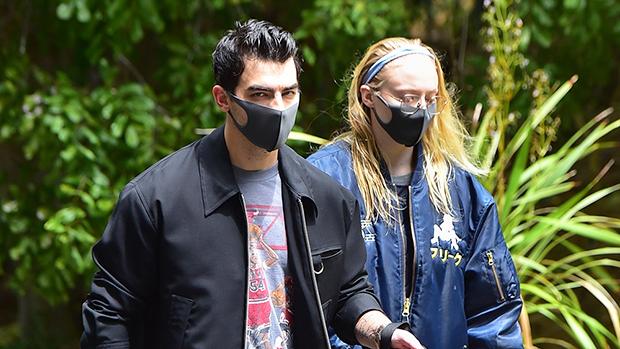 Joe Jonas & Sophie Turner walking their dog