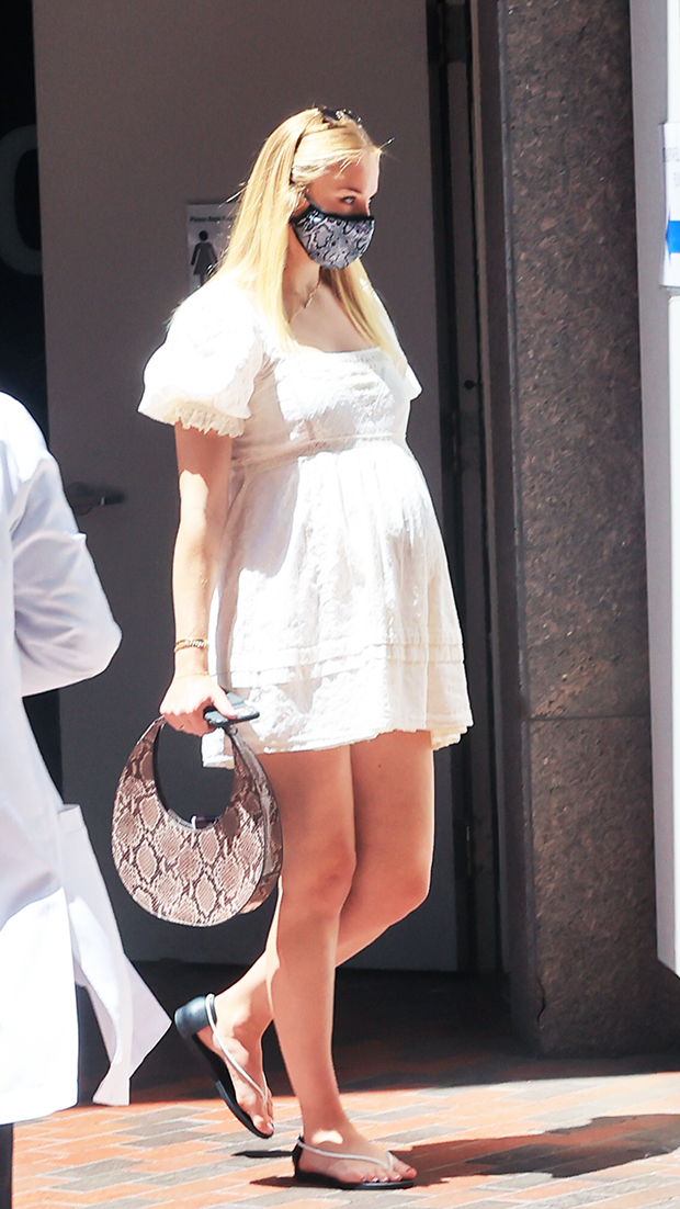 Sophie Turner in a white dress