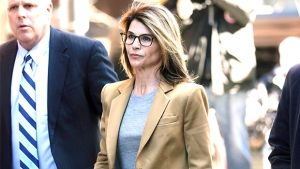 Lori Loughlin Reports To Prison To Serve Time For College Admissions Scandal