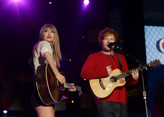"""Taylor Swift and Ed Sheeran. File photo dated 09/06/13 of Taylor Swift and Ed Sheeran, as Ed Sheeran has said he will """"always stick up"""" for his good friend and fellow singer Taylor Swift. Issue date: Sunday June 25, 2017. Sheeran, 26, and Swift, 27, have been firm friends since he toured with her in 2013.Chart-topping singer-songwriter Sheeran also revealed he """"hooked up"""" with some of her famous friends in the early days of their friendship.See PA story SHOWBIZ Sheeran. Photo credit should read: Yui Mok/PA Wire URN:31820910"""