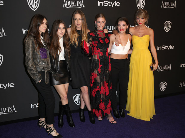 From left, Danielle Haim, Alana Haim and Este Haim of Haim with Jaime King, Lorde and Taylor Swift arrive at the 16th annual InStyle and Warner Bros. Golden Globes afterparty at the Beverly Hilton Hotel on Sunday, Jan. 11, 2015, in Beverly Hills, Calif. (Photo by Matt Sayles/Invision/AP)