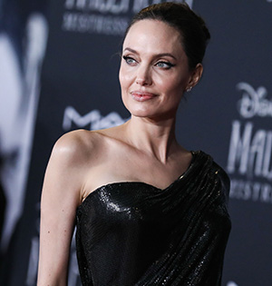 HOLLYWOOD, LOS ANGELES, CALIFORNIA, USA - SEPTEMBER 30: Actress Angelina Jolie wearing Atelier Versace with Cartier jewelry arrives at the World Premiere Of Disney's 'Maleficent: Mistress Of Evil' held at the El Capitan Theatre on September 30, 2019 in Hollywood, Los Angeles, California, United States. 30 Sep 2019 Pictured: Angelina Jolie. Photo credit: Xavier Collin/Image Press Agency / MEGA TheMegaAgency.com +1 888 505 6342 (Mega Agency TagID: MEGA549897_005.jpg) [Photo via Mega Agency]