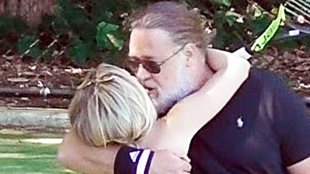 Russell Crowe, 56, Passionately Kisses Rumored Girlfriend Britney Theriot, 30, During Tennis Match