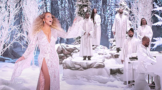 Mariah Carey, 50, Is The Christmas Queen Rocking A Stunning White Gown & More In Holiday Special