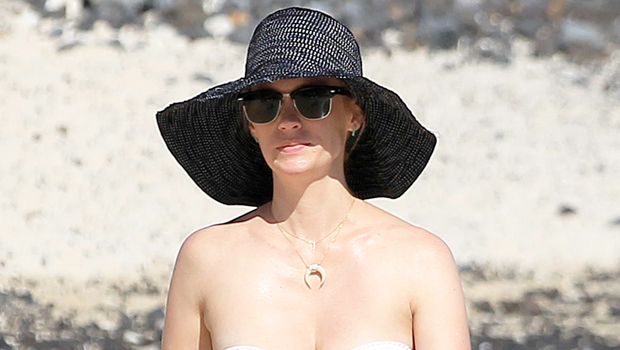 January Jones, 42, Rocks Sexy Swimsuit & Admits She's 'Missing The Snow' This Christmas