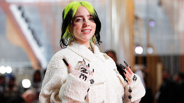 Billie Eilish Smacks Herself & Cracks Up While Rocking A Cozy Tank Top On The Couch