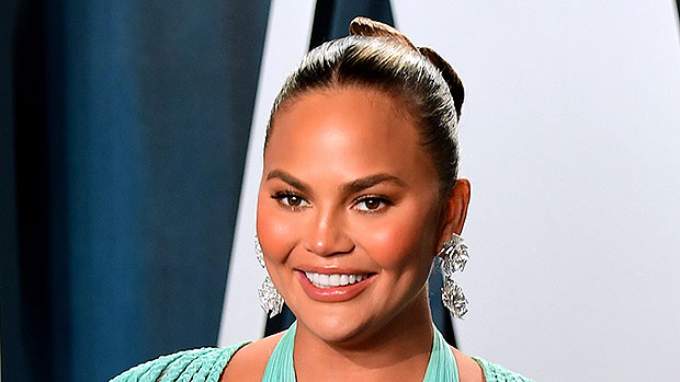 Chrissy Teigen Bares All 6 Months After Removing Breast Implants As She Celebrates NYE In The Caribbean