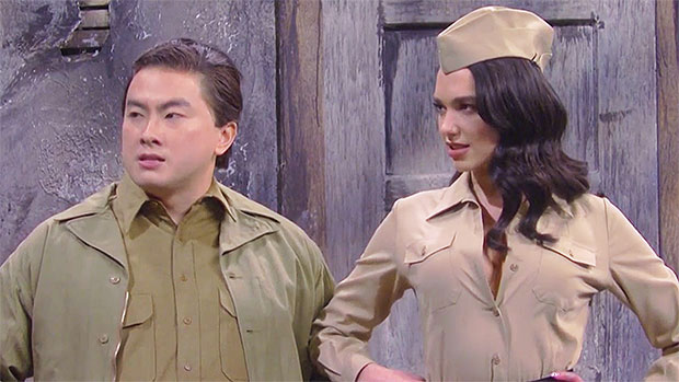 Dua Lipa Makes Cameo As Kristen Wiig & Bowen Yang's 'Soldiers' Spoof A Whitney Houston Classic