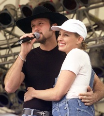 """**FILE** Country music singers Tim McGraw and his wife, Faith Hill, perform together at the Internatonal Country Music Fan Fair festival in Nashville, Tenn., in this file photo from June 17, 1997.  The dual will return this summer for another go-round of their hugely successful Soul2Soul tour. """"This is why we get into this business,"""" McGraw said Wednesday March 7, 2007, in announcing the shows with Hill. """"To be on stage and sing in front of thousands of people."""" (AP Photo/Mark Humphrey-File)"""
