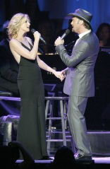 Faith Hill and Tim McGraw perform during the Andre Agassi Charitable Foundation's Grand Slam for Children at MGM Grand Hotel and Casino Saturday, Oct. 2, 2004. Proceeds  go to benefit underprivileged, abused and abandoned children. (AP Photo/Matthew Minard)