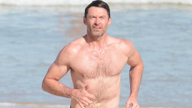 Hugh Jackman, 52, Goes Shirtless For Freezing 'Polar Bear Plunge' Swim On New Year's Day — Watch