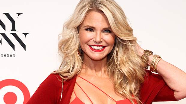 Christie Brinkley, 66, Rocks Plunging Red Mini Dress For Bike Ride On Tropical Vacation