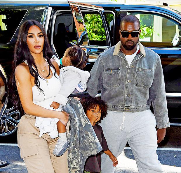 Kim Kardashian & Kanye West with their kids