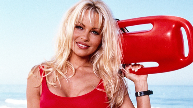 Pamela Anderson, 53, Pays Homage To Her 'Baywatch' Role In Cropped Top Lifeguard Hoodie — Watch