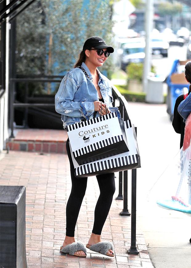 Chrissy Teigen shopping in slip-on scandals