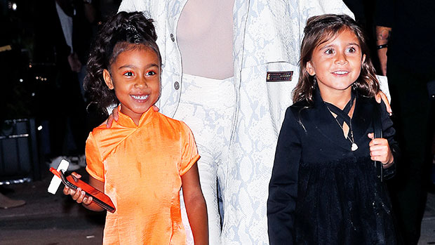 North West, 7, & Cousin Penelope Disick, 8, Are So Cute 'Daydreaming' On The Beach — See Pics