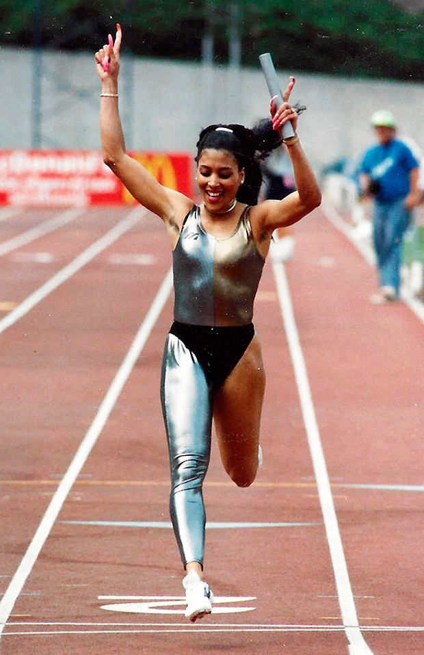 Flo-Jo running in a one-legged catsuit